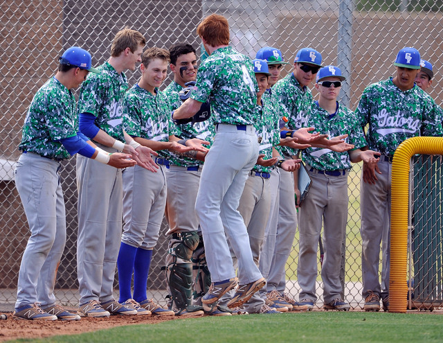 Green Valley's Keaton Smith (4) celebrates with teammates after hitting a home run aga ...