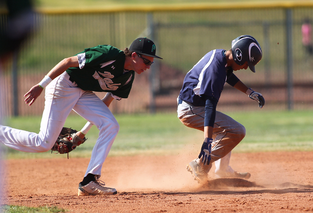 Shadow Ridge's Robbie Galvan, right, slides safely into second base as Palo Verde&#821 ...