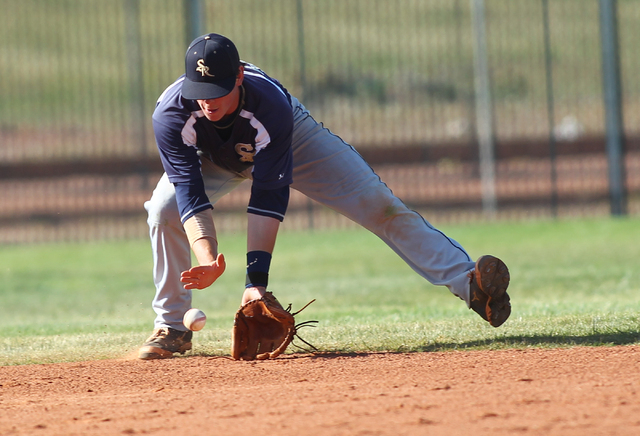 Shadow Ridge's Brady Hoskins fields a grounder while playing against Palo Verde on Thu ...