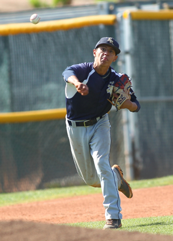 Shadow Ridge third baseman Robbie Galvan throws to first to get an out against Palo Verde on ...