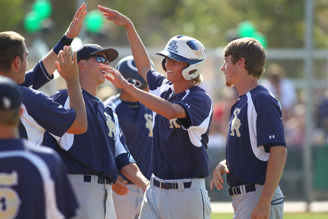 Shadow Ridge's Travis Caskie, center right, celebrates with teammates after scoring a ...