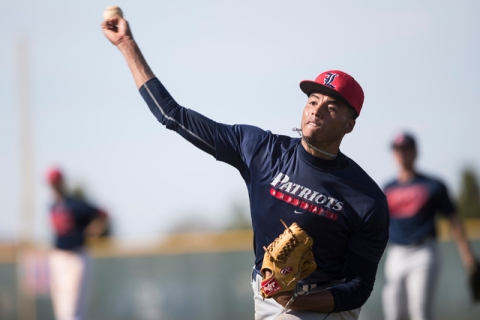 Liberty's senior Ed O'Bannon throws the ball during a team practice at Liberty H ...