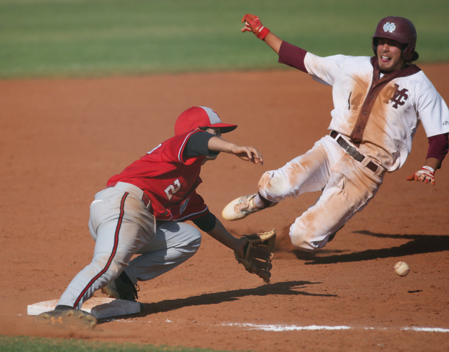 Arbor View's Quinn Gallagher, left, goes for a catch as Cimarron-Memorial's Niko ...