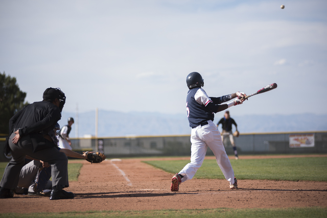 Coronado's Donte Glover (5) hits the ball against Basic during their baseball game at ...
