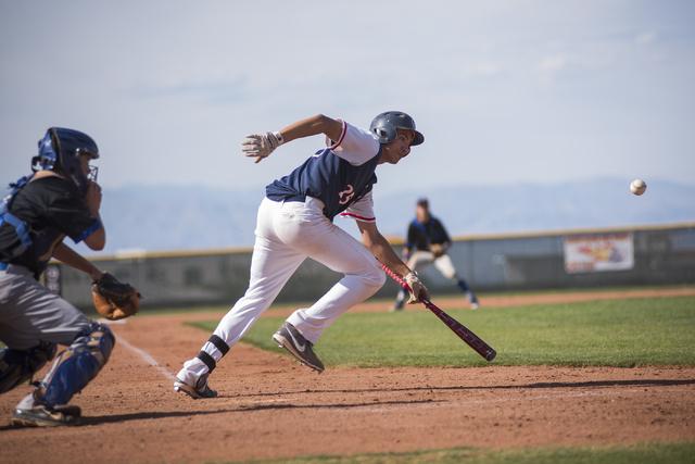 Coronado's Dakota Humphries (25) bunts the ball against Basic during their baseball ga ...