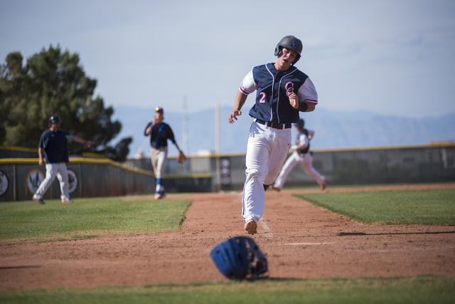 Coronado's Corben Bellamy (2) scores a run against Basic during their baseball game at ...