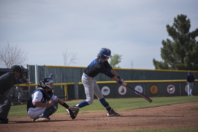 Basic's Ryne Nelson (29) hits the ball in front of Coronado catcher Corben Bellamy dur ...