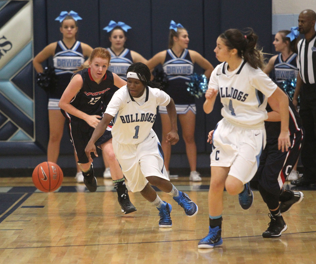 Centennial guard Pam Wilmore (1) goes for a loose ball in front of Coronado guard Katie Thor ...