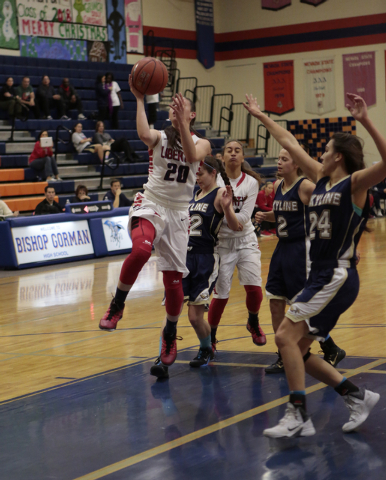 Liberty's Kealy Brown (20) goes in for a layup during the first half on Thursday. (Don ...