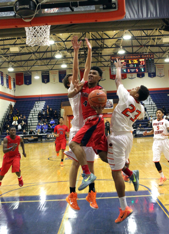 Findlay Prep guard Allonzo Trier (4) goes up for a shot between Wasatch Academy forward/cent ...