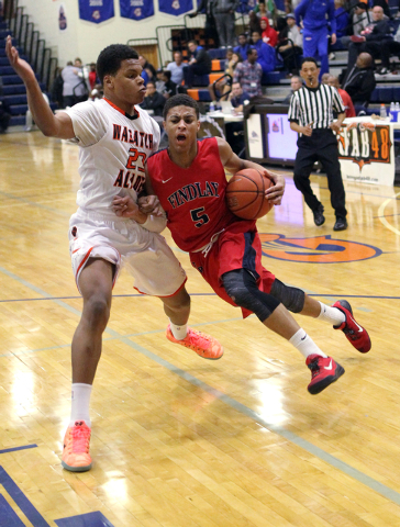 Findlay Prep point guard Derryck Thornton Jr. (5) drives past Wasatch Academy guard/forward ...