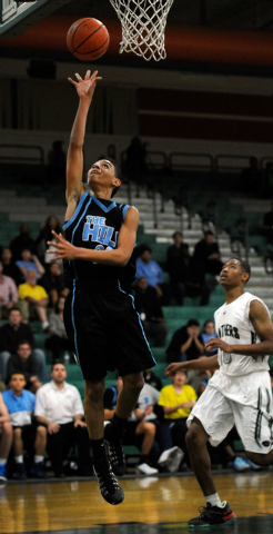 Foothill's Marvin Coleman (23) shoots as Palo Verde's Ja Morgan looks on during ...