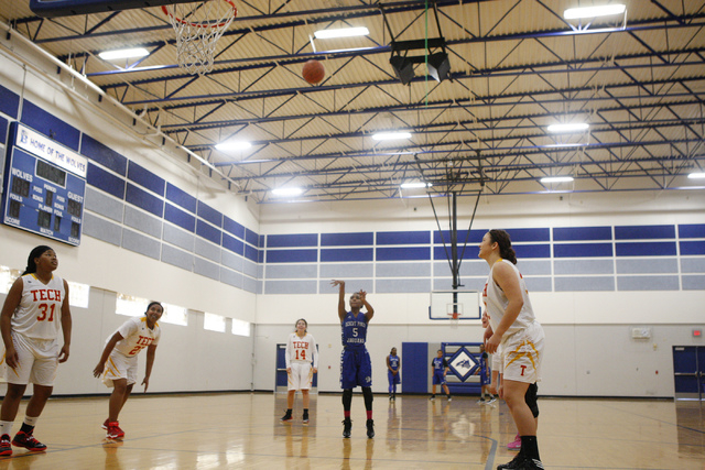 Desert Pines' Chrystian Myles (5) shoots a free throw during Tuesday's game agai ...