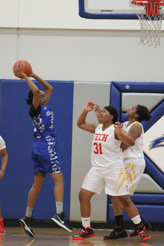 Desert Pines' Adrianne Jackson (20) looks to pass against Tech in the Lady Wolves Holi ...