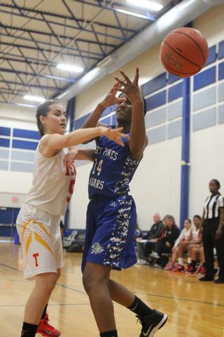 Tech's Jasmine Ramos (5) knocks the ball loose from Desert Pines Tanauya Hinton (14) d ...
