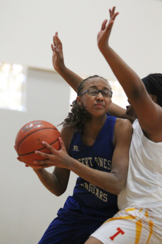Desert Pines' Brianna Fitzgerald (24) looks for an opening against Tech's Patric ...