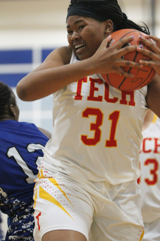 Tech's Patrice Thomas (31) grabs the ball against Desert Pines in the Lady Wolves Holi ...