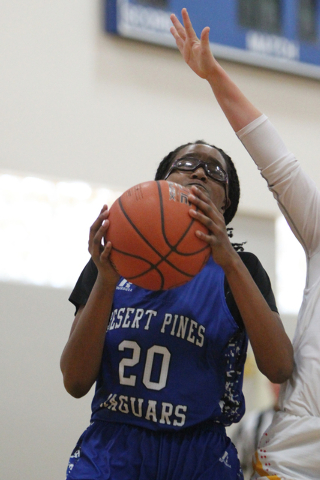 Desert Pines' Adrianne Jackson (20) looks for an open shot against Tech in the Lady Wo ...