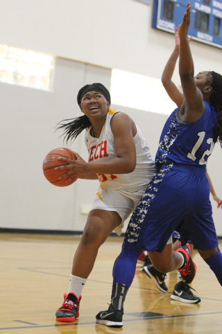 Tech's Patrice Thomas (31) looks for an open shot against Desert Pines See'Airra ...