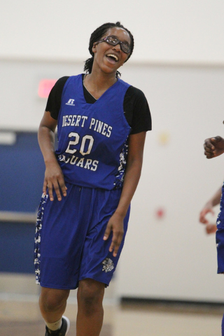 Desert Pines' Adrianne Jackson (20) reacts after making a jump shot during a game agai ...