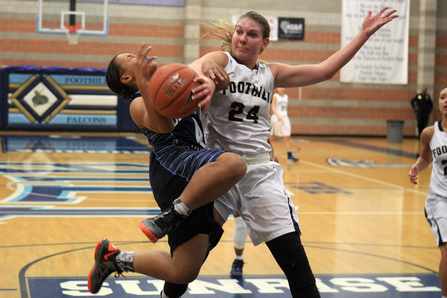 Foothill's Gabby Doxtator fouls Canyon Springs' Alize Bell on Tuesday. Doxtator ...