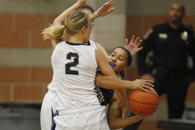 Canyon Springs' Alize Bell is fouled by Foothill's Mikayla Yeakel on Tuesday. Fo ...