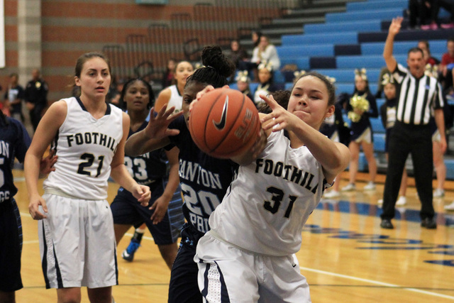 Foothill's Bri Rosales grabs a rebound from Canyon Springs' Alexia Thrower on Tu ...