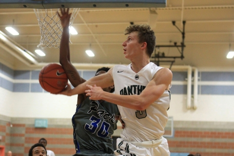 Palo Verde's Grant Dressler puts up a reverse layup while being defended by Basic forw ...