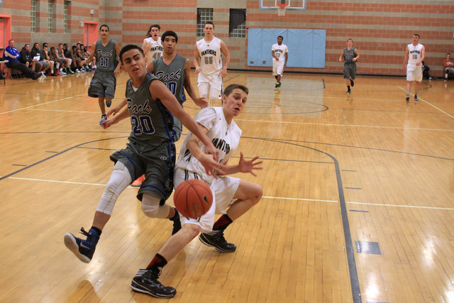 Basic guard Chaz Lucero knocks the ball out of the hands of Palo Verde's Thomas Reymon ...