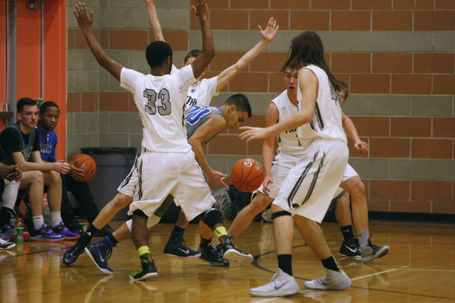 Basic guard Chaz Lucero finds himself surrounded by Palo Verde players at the Foothill Holi ...