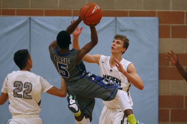 Palo Verde's Grant Dressier defends a shot by Basic guard Kerry Keyes on Friday. Palo ...