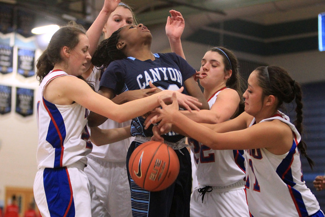 Canyon Springs guard Alexia Thrower looses the ball to Reno players, from left, Megan Dericc ...