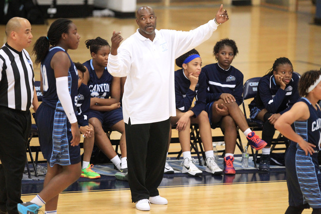 Canyon Springs coach Stan Nelson gathers his players during their Las Vegas Holiday Classic ...