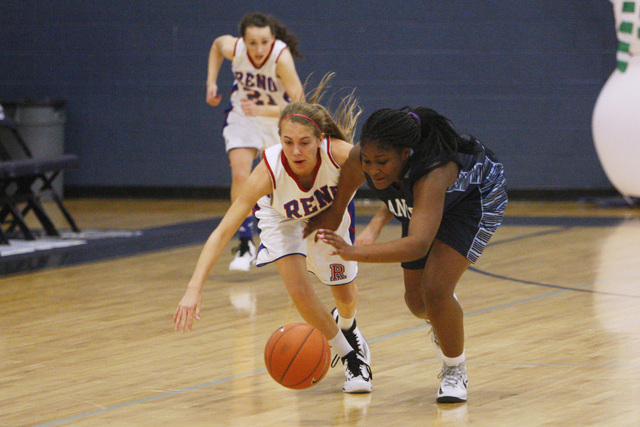 Canyon Springs guard Destini Hunter steals the ball from Reno guard Mikayla Shults during th ...