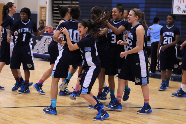 Centennial players celebrate as time expires in their championship game against Liberty at t ...