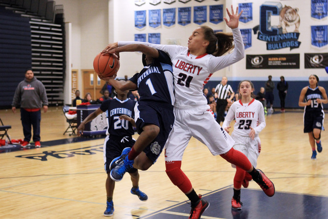 Centennial guard Pam Wilmore is fouled by Liberty guard Kaily Kaimikaua during the champions ...
