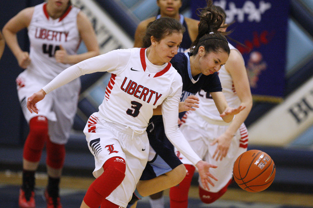 Liberty guard CeCe Quintino and Centennial guard Courtney Walker chase a loose ball during t ...