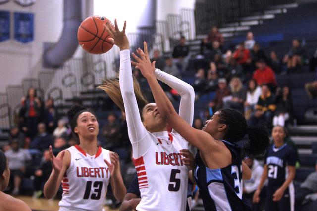 Centennial guard Megan Jefferson defends Liberty forward Jaelyn Royal during the championshi ...