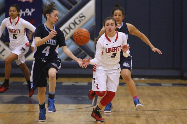 Centennial guard Courtney Walker fouls Liberty guard CeCe Quintino during the championship g ...