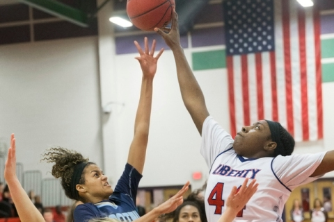 Foothills Rae Burrell (12) has her shot blocked by Liberty's Dre'una Edwards (44 ...