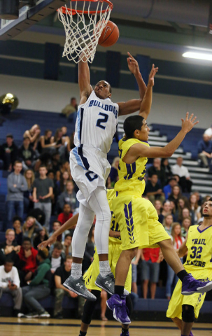 Centennial's Troy Brown (2) goes up for a shot over Durango's Apollo Corley on Frida ...