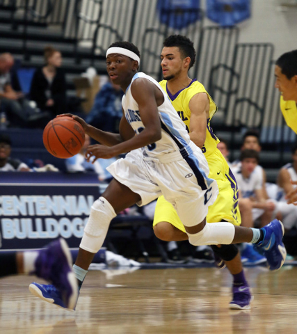 Centennial's Isaiah Banks, left, dribbles the ball in front of Durango's Victor Ross ...
