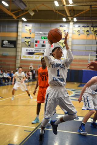 Foothill's Kevin Woodland (1) goes up for a layup against National Prep Academy' ...