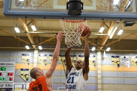 Foothill's Torrance Littles (21) goes up for a shot against National Prep Academy&#821 ...
