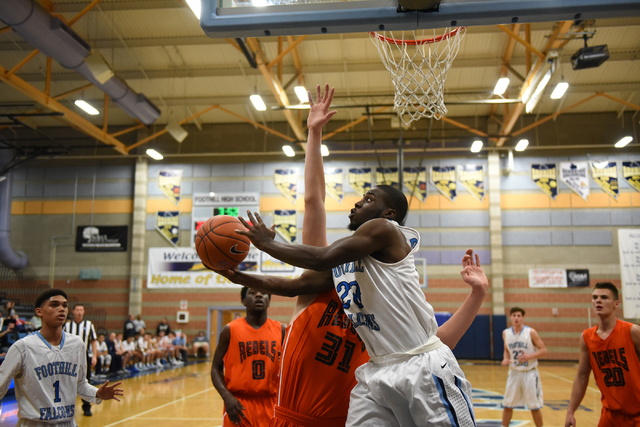 Foothill's Te'Vion Reed (20) goes up for a shot against National Prep Academy&#8 ...