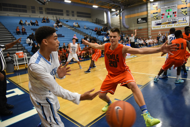 Foothill's Kevin Woodland (1), left, passes the ball past National Prep Academy' ...