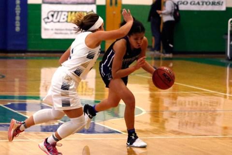 Durango's Aaliyah Matthews (11) drives towards the hoop during a high school basketbal ...