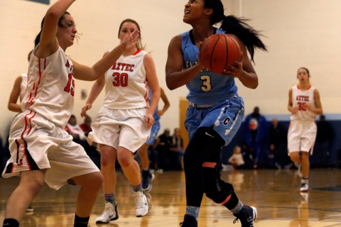 Centennial's Lauren Welch (3) drives towards the hoop during a high school basketball ...