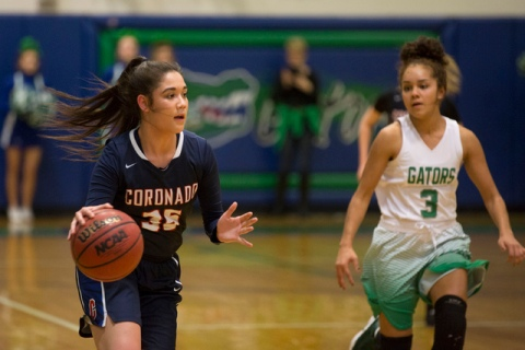 Coronado junior Haley Tyrell (35), left, takes the ball to the basket during a game at Green ...