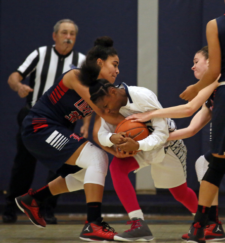 Liberty's Paris Strawther, from left, Canyon Springs' Alexia Thrower and Liberty ...